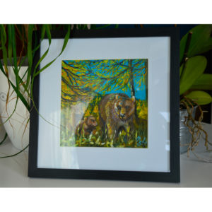 Framed painting representing a family of bears.