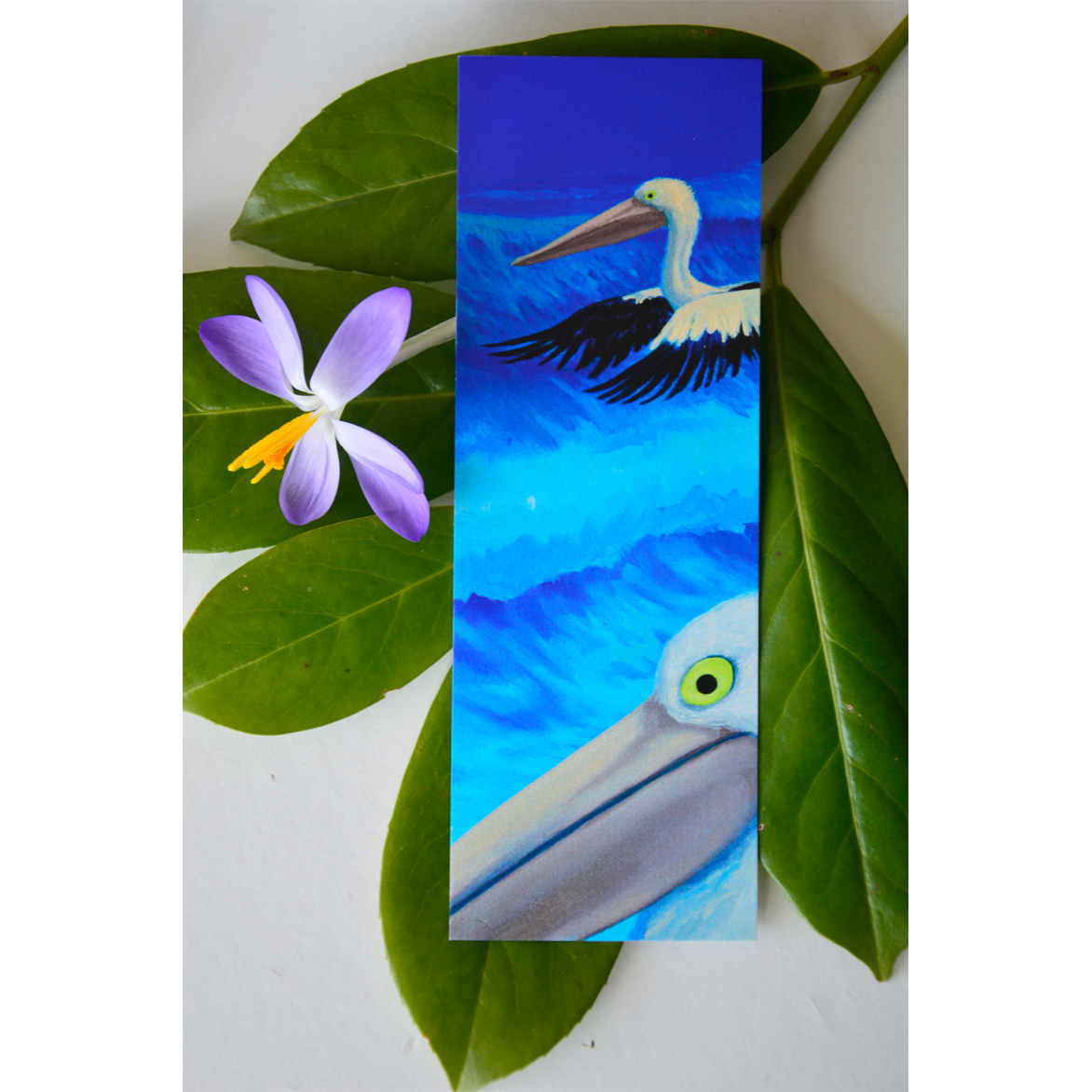 Wildlife painting bookmark with pelicans.